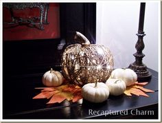DIY pumpkin.  Wrap twine around balloon, pop balloon, shape twine a little, spray paint if you want and string lights inside. inexpensive!