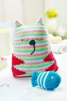"""Mindy the Cat and Freddie the Fishy Snak Free Knitting Pattern ( You will need to be registered with """"Let's Knit"""" to open the files, just click the Blue Box """"Sign Up to Download Pattern"""" to fill register form) ( PDF File Zip format) here: http://www.letsknit.co.uk/free-knitting-patterns/mindy-and-freddie"""