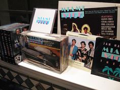 "My Miami Vice collection- (2013) all 5 seasons/DVD, Monogram Ferrari Daytona model (1986), MV soundtrack vinyl record, CD & 2 45 rpm records: Jann Hammer Miami Vice Theme & Glenn Frey's ""You Belong to the City/Smuggler's Blues"""
