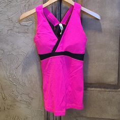 Lululemon Hot Pink Top Excellent condition. Has pads in top! lululemon athletica Tops Tank Tops