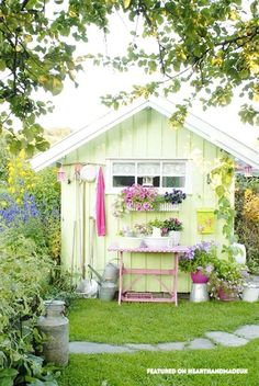 In Need Of Shed Color Ideas?! A beautiful shabby chic garden shed in bright colours using a vintage singer sewing machine. Cute Garden Pastel Shed