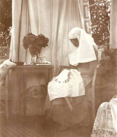 Grand Duchess Tatiana Nikolaevna Romanova of Russia in her Red Cross nurse's uniform embroidering in 1915.A♥W