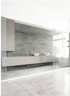 Minimal bathroom | concrete floor and walls, sliding glass doors