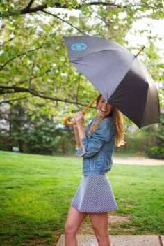 The Fashionably Broke #rocking a Jonas #umbrella during a #sunny #rain! Go see their #blog to #signup for a #giveaway!