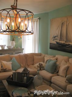 Lucketts Spring Market Design House - love the chandelier + sailboat art + colors