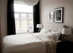 Light grey bedroom, dark dramatic curtains. | Anette's Scandinavian Lookout