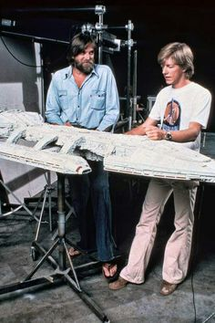 Special effects master John Dykstra and an unknown man in a Star Wars t-shirt, with the filming miniature of the Battlestar Galactica, circa 1978 Movie Props, I Movie, Kampfstern Galactica, Best Sci Fi Shows, Battlestar Galactica 1978, Pintura Exterior, Sci Fi Models, Sci Fi Ships, Classic Tv