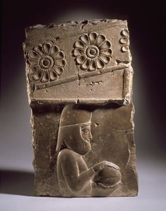 ~ Relief of a gift bearer from Persepolis. Place of origin: Southern Iran, Persepolis Date: 500-450 B.C. Medium: Stone