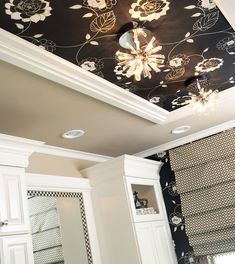 Wallpapered ceilings have the ability to create an interest and an illusion of depth, and enhance the detail of beautiful molding.