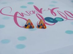Hand drawn triangular shrink plastic earrings with the appearance of painted wood