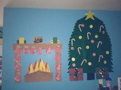 Daycare wall decorated for Christmas. Using construction paper and felt.