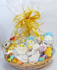 Gift wrapping baskethampers adds value to packaged gifts diy a cute baby shower gift basket with a white dotted cellophane gift wrap negle Image collections