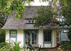 Old French Cottage | Little cottage with French doors and an eyebrow window.