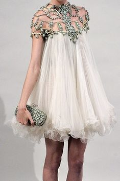 Marchesa - beautiful not jewels required , hair up in a tousled pony tail to off set the dress strappy sandles in muted silver