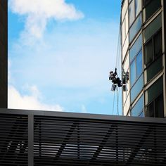 Hanging out cleaning windows at OCBC Centre