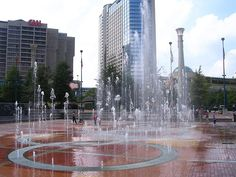 Fountain of Rings, Omni Hotel, CNN Center that was so neat i stood near one and got splashed in the face  to my feet