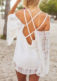 Get attention with this beautiful crisscross cold shoulder tunic.