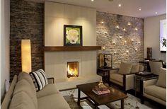 Wonderful texture.  Large sleek stone tile, rough stone wall, warm wood mantle.