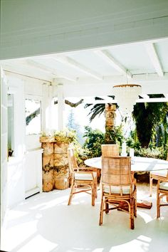 On the patio, custom table and chairs from Bali; LUMU INTERIORS candlesticks.