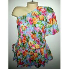 22/24W Lane Bryant One Shoulder Peplum Top Size 22/24 (size 3X equivelent) one shoulder peplum top from Lane Bryant. Blue background with a bright colorful Hawaiian style print. Comes with a braided cloth belt.  New with tags. Lane Bryant Tops