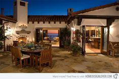 A romantic dinner in this courtyard could be something anyone would wish for. The wooden furniture matches well with the house design as well as the stone flooring.