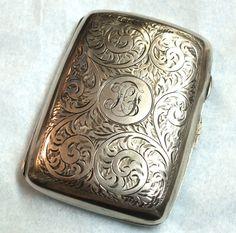 Vintage Antique Sterling Silver Art Nouveau Cigarette Case with Chased Engraving. $114.99, via Etsy.