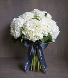 Love the simple elegance of this bouquet. Would opt for thick brown     ribbon, maybe with a rhinestone or turquoise brooch incorporated in the bouquet.