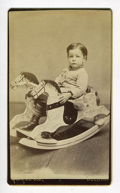 child with rocking horse  just like the one my Grandpa made for Dad!