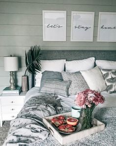 coastal casual chic bedroom decor, white and grey, gray bedding, headboard, white nightstand, three frames prints above king bed