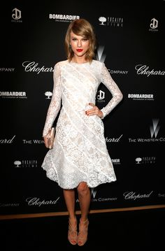 Taylor Swift in a white dress by Oscar de la Renta at the Weinstein Company's party.