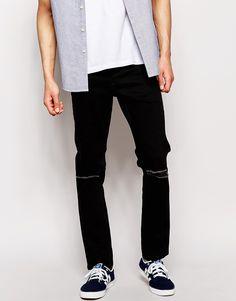 Schmal geschnittene Jeans von Jack & Jones Stretch-Denim mit verdecktem Reißverschluss Fünf-Taschen-Stil geschlitzte Kniepartie schmale Passform, sitzt eng am Körper Maschinenwäsche 98% Baumwolle, 2% Elastan Model trägt 32 Zoll/81 cm Normalgröße und ist 185,5 cm/6 Fuß 1 Zoll groß