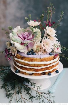 Baked with juicy blueberries and featuring layers of thick cream cheese frosting, this cake is an utterly irresistible delight! | Photographer: Tasha Seccombe Photography | Food Stylist: The Food Fox