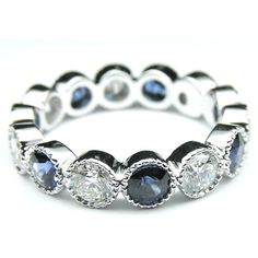 Diamond & Blue Sapphire Vintage Eternity Wedding Ring ($2,695) ❤ liked on Polyvore featuring jewelry, rings, diamond jewelry, vintage jewelry, vintage rings, blue sapphire ring and diamond rings