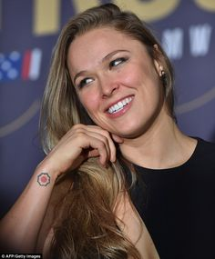 Second time's the charm! Rousey, who is pictured showing off one of the tattoos at a press conference before her UFC loss to Holly Holm in November, also starred in a shoot for Sports Illustrated Swimsuit last year