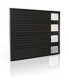 Get ready for the Mod Squad as Clopay debuts new contemporary garage door designs manufactured in wood and steel in booth C1062 at The International Builders' Show (IBS) Jan. 20 - 22, 2015. Here's a sneak preview of the Model 9205 contemporary ribbed steel door in black with etched glass windows. Features Intellicore insulation technology. www.clopaydoor.com