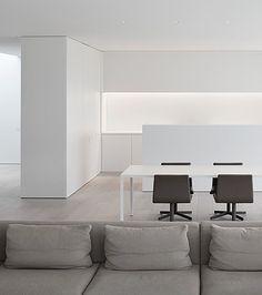 Minimal white kitchen, by architect Pascal Bilquin. Interior execution by Minus.