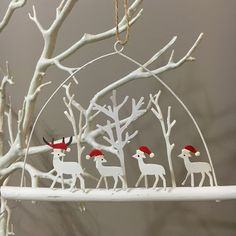 white reindeer on a branch.Hanging Christmas decoration.Shoeless joe.Shabby chic
