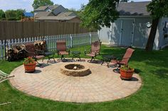 You can have this patio and fire pit in your backyard - it's a DIY home improvement project and a great addition to any house.