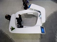 Overhead perspective shows touchscreen built into the end of the desk