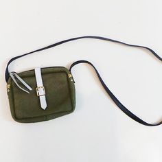 Small green ponyhair Claire Vivier crossbody  Find more unique consignment pieces at www.revolverboutique.com