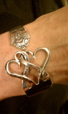 Creative ...  using the tines of a fork to create intertwined hearts.  A bracelet or napkin ring ... Luv hearts ...