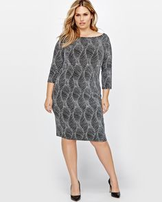 Get the party started in this chic and sexy plus size dress by Michel Studio. Featuring a luxurious silver glitter design. <br /><br />Fit & cut<br />- 3/4 sleeves<br />- Bodycon <br /><br />Design details<br />- Silver glitter pattern