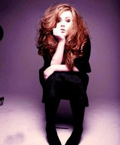 Adele looks pretty here! Love the hair