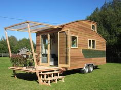 """La Tiny House builds tiny homes in France. They build several different designs from more traditional looking gable roofed homes, to curved roof homes like the one pictured here that they call the """"tinystream&#8221..."""