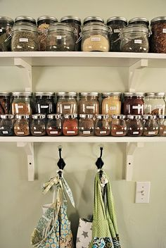 Spices in jars, open shelves - I would love to have this in my kitchen. (Organization ideas for lots of rooms in your house.)