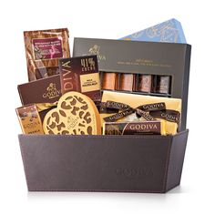 The perfect luxury gift idea for chocolate lovers, this prestigious Godiva gift hamper includes an irresistible assortment of premium Belgian chocolates, truffles, nuts, and more.