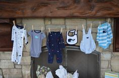 baby boy shower decorations - like the idea of boy bibs, and clothes hanging like this for decoration