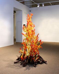 """""""Re-kindling"""" (2008)  Plywood, ink, spray paint, and acrylic paint   4 foot diameter x 6 feet"""
