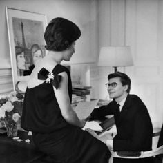 April 1960    Mme. Mathieu Saint Laurent is wearing a Christian Dior dress with a pin on the back right shoulder, is seated with her son Yves Saint Laurent.    Image by © Condé Nast Archive/Corbis