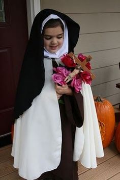 This little girl has a beautiful St. Therese of Lisieux costume!